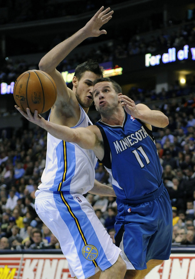 Minnesota Timberwolves guard Jose Juan Barea (11) shoots around Denver Nuggets forward Danilo Gallinari, from Italy, during the second quarter of an NBA basketball game on Thursday, Jan. 3, 2013, in Denver. (AP Photo/Jack Dempsey)