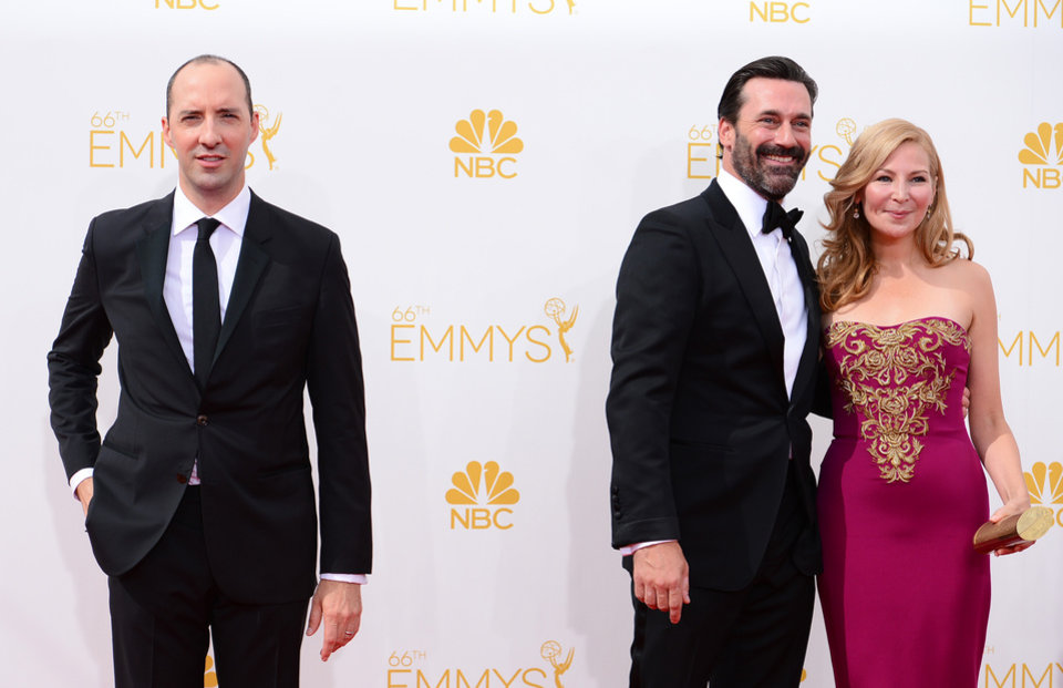 Photo - Tony Hale, from left, Jon Hamm and Jennifer Westfeldt arrive at the 66th Annual Primetime Emmy Awards at the Nokia Theatre L.A. Live on Monday, Aug. 25, 2014, in Los Angeles. (Photo by Jordan Strauss/Invision/AP)
