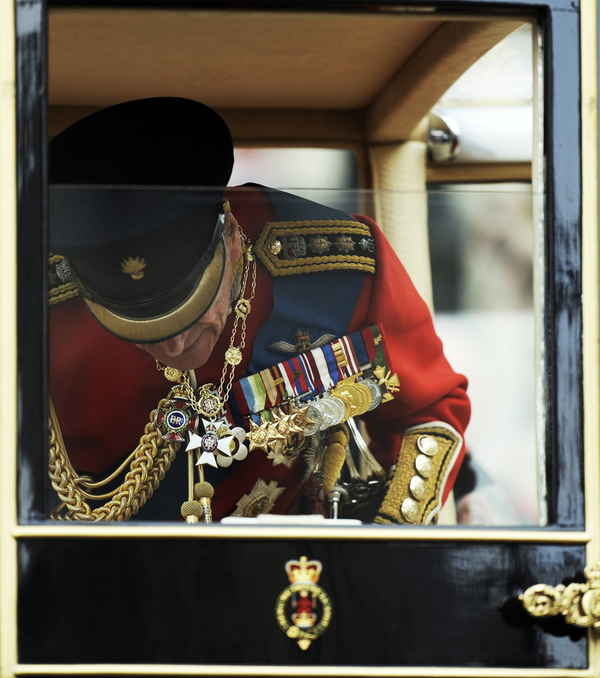 Photo - Britain's Prince Philip gets inside a carriage outside Westminster Abbey after the Royal Wedding for Britain's Prince William and his wife Kate, Duchess of Cambridge in London Friday, April, 29, 2011. (AP Photo/Martin Meissner) ORG XMIT: RWMG165
