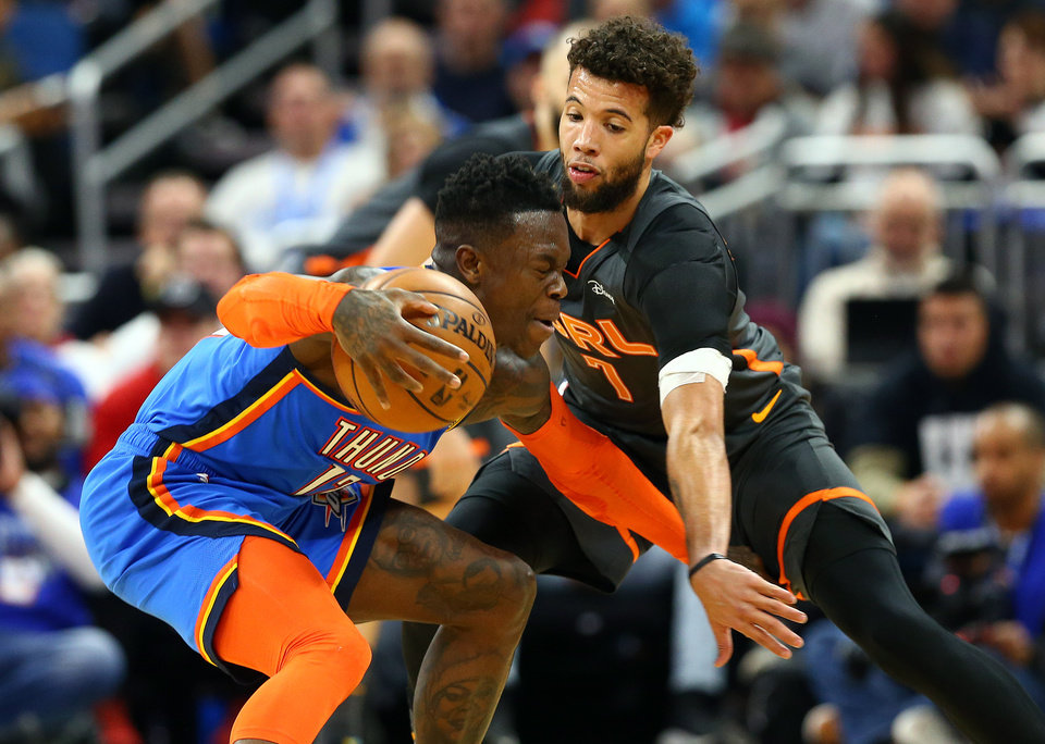 Photo - Jan 22, 2020; Orlando, Florida, USA; Oklahoma City Thunder guard Dennis Schroder (17) drives to the basket as Orlando Magic guard Michael Carter-Williams (7) defends during the second half at Amway Center.  [Kim Klement/USA TODAY Sports]