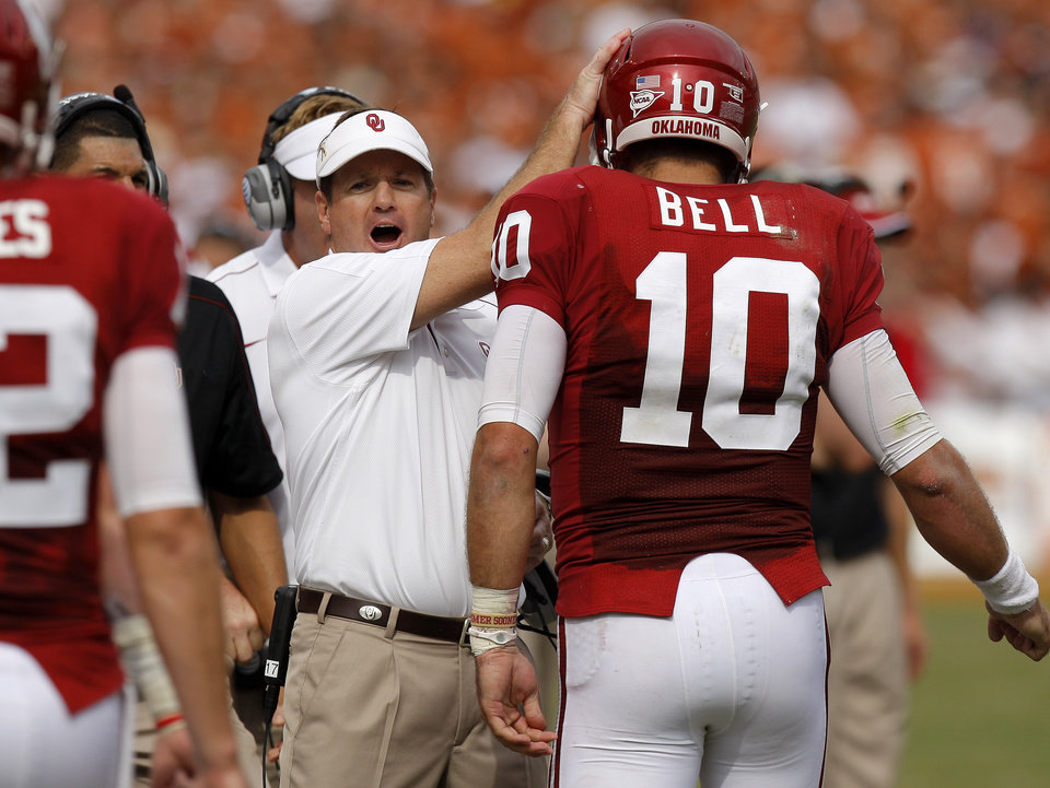 CELEBRATION: Oklahoma coach Bob Stoops celebrates with OU's Blake Bell (10) after a touchdown during the Red River Rivalry college football game between the University of Oklahoma (OU) and the University of Texas (UT) at the Cotton Bowl in Dallas, Saturday, Oct. 13, 2012. Photo by Bryan Terry, The Oklahoman