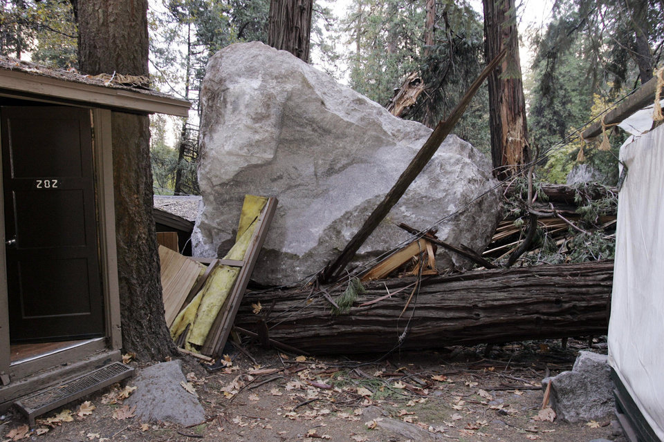 Photo -   FILE - In this Monday, Oct. 20, 2008 file photo, a boulder sits atop debris after it fell in Curry Village in Yosemite National Park, Calif. Falling boulders are the single biggest force shaping Yosemite Valley, one of the most popular tourist destinations in the national park system. Now swaths of some popular haunts are closing for good after geologists confirmed that unsuspecting tourists and employees are being lodged in harm's way. On Thursday, June 13, 2012, the National Park Service will announce that potential danger from the unstable 3,000-foot-tall Glacier Point, a granite promontory that for decades has provided a dramatic backdrop to park events, will leave some of the valley's most popular lodging areas permanently uninhabitable. (AP Photo/Paul Sakuma, File)