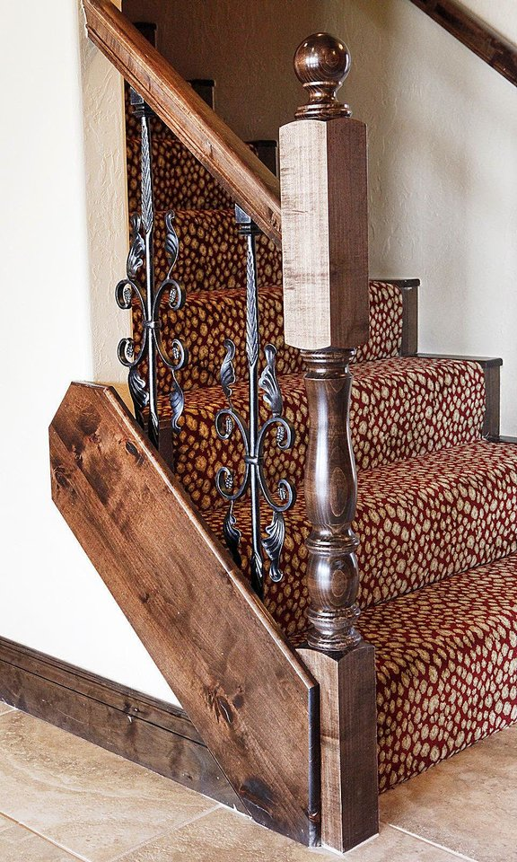 Photo - Custom detail work adorns the stairs in the Moore Home Builders Association's project house, built by R&R Homes at 1105 Dayton Lane.  David McDaniel - The Oklahoman
