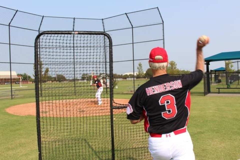 Photo -  Mike Henderson of Purcell pitches batting practice to a men's senior baseball squad. [ED GODFREY/THE OKLAHOMAN]