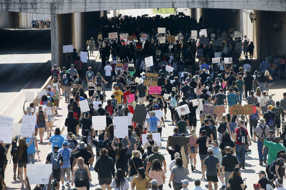Photo - Protesters head west on NE 23rd to the state Capitol in Oklahoma City on Sunday, May 31, 2020. The Black Lives Matter protest was in response to the death of George Floyd. [Bryan Terry/The Oklahoman]