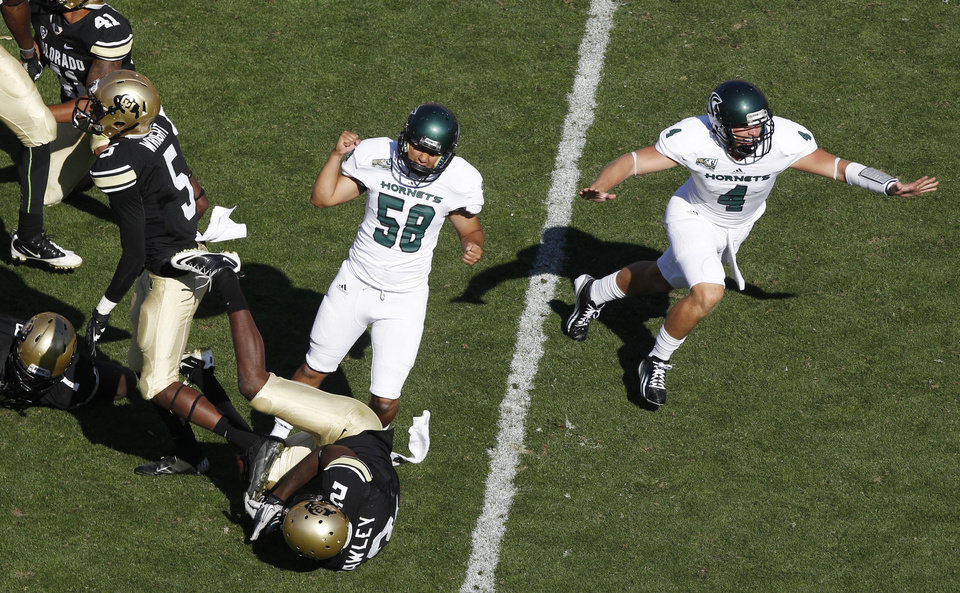 Photo -   Sacramento State place kicker Edgar Castaneda, third from left, celebrates making the winning field goal with holder Mason Magleby, far right, as Colorado special teams players Yuri Wright, far left, and Keneth Crawley watch in the fourth quarter of their NCAA college football game in Boulder, Colo., Saturday, Sept. 8, 2012. Sacramento State won 30-28. (AP Photo/David Zalubowski)