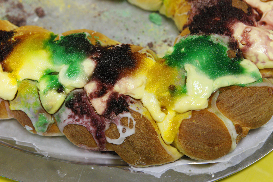 Photo - A king cake covered with colored sugar and icing is one of the baked goods sold as part of a fundraiser at Douglas Boulevard United Methodist Church in Midwest City.  PAUL B. SOUTHERLAND - PAUL B. SOUTHERLAND