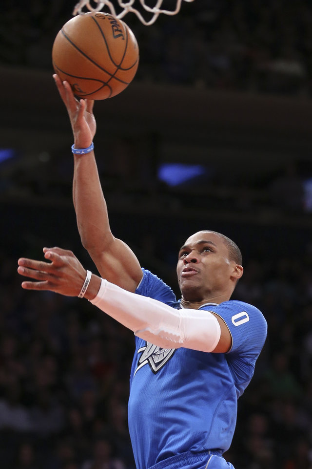 Photo - Oklahoma City Thunder guard Russell Westbrook shoots during the second half of the Thunder's NBA basketball game against the New York Knicks at Madison Square Garden, Wednesday, Dec. 25, 2013, in New York. The Thunder won 123-94. (AP Photo/John Minchillo)
