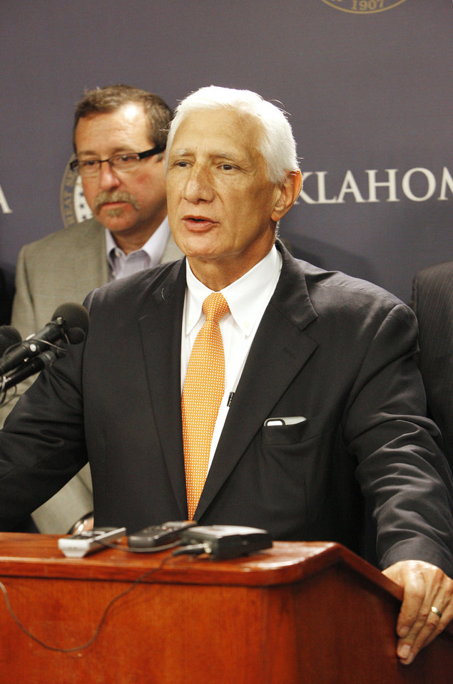 Photo - Steven Farris, Apache Corp. chairman and CEO, speaks Thursday during a press conference announcing the formation of Shelter Oklahoma Schools at the state Capitol in Oklahoma City . State Reps. Mark McBride, Richard Morrissette, Jon Echols, Eric Proctor and John Trebilcock formed the entity with the purpose of helping provide storm shelter or safe rooms for existing schools. Photo by Paul B. Southerland, The Oklahoman  PAUL B. SOUTHERLAND - PAUL B. SOUTHERLAND