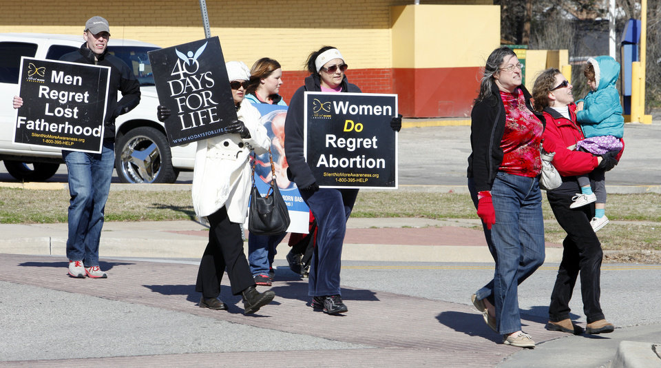 Anti-abortion demonstrators march along NW 23 Street Monday as they participate in the 2013 March for Life OKC. Marchers walked from Our Lady's Cathedral at 3214 N Lake Ave. to the state Capitol building. <strong>PAUL B. SOUTHERLAND - PAUL B. SOUTHERLAND</strong>