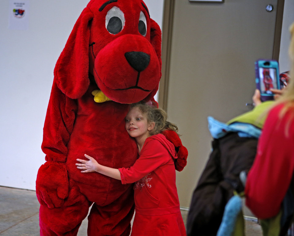 Kinley Greenhaw, 10, has her photo taken with Clifford the Big Red Dog.