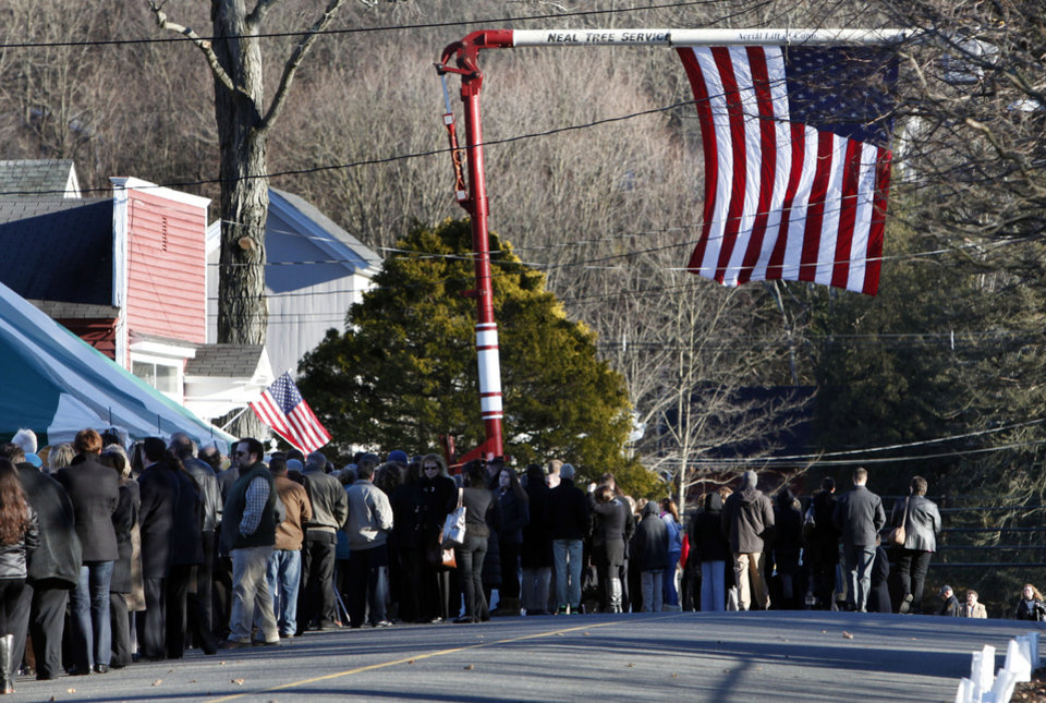Mourners line up to enter the calling hours for Sandy Hook Elementary School principal Dawn Lafferty Hochsprung, Wednesday, Dec. 19, 2012, in Woodbury, Conn.  Hochsprung was killed when a gunman forced his way into Sandy Hook Elementary School in Newtown Friday and opened fire, killing 26 people, including 20 children. (AP Photo/Jason DeCrow)