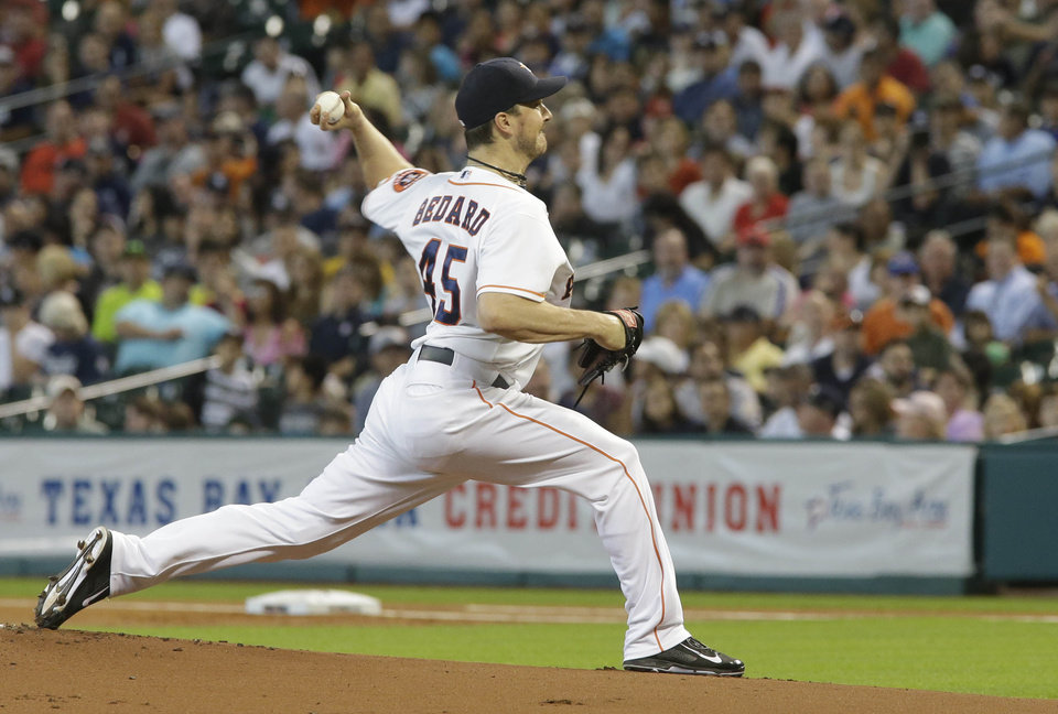 Photo - Houston Astros pitcher Erik Bedard delivers a pitch against the New York Yankees during the first inning of their baseball game Sunday, Sept. 29, 2013, in Houston. (AP Photo/Richard Carson)