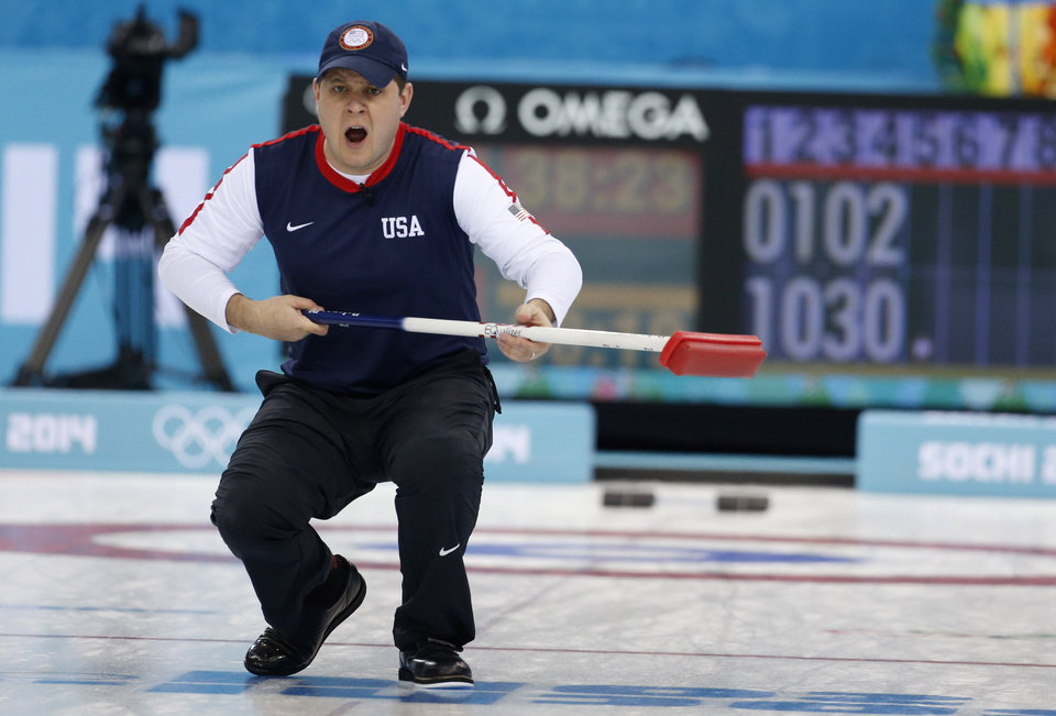 Photo - John Shuster, skip of the United States team, reacts as his shot entrers the house during men's curling competition against China at the 2014 Winter Olympics, Tuesday, Feb. 11, 2014, in Sochi, Russia. (AP Photo/Robert F. Bukaty)