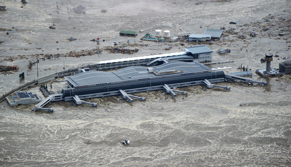 Photo - Sendai Airport is surrounded by waters in Miyagi prefecture (state), Japan, after a ferocious tsunami spawned by one of the largest earthquakes ever recorded slammed Japan's eastern coast Friday, March 11, 2011.  (AP Photo/Kyodo News) JAPAN OUT, MANDATORY CREDIT, FOR COMMERCIAL USE ONLY IN NORTH AMERICA ORG XMIT: TTX815