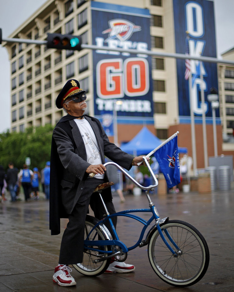 "Photo - Kenny Keels ""Captain Thunder"" sits on his bike outside Chesapeake Energy Arena before Game 4 of the Western Conference Finals in the NBA playoffs between the Oklahoma City Thunder and the San Antonio Spurs at Chesapeake Energy Arena in Oklahoma City, Tuesday, May 27, 2014. Photo by Bryan Terry, The Oklahoman"