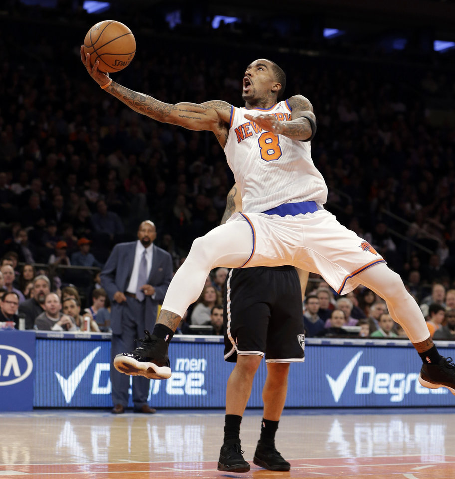 New York Knicks guard J.R. Smith (8) shoots a layup against the Brooklyn Nets in the first half of their NBA basketball game at Madison Square Garden in New York, Monday, Jan. 21, 2013. (AP Photo/Kathy Willens)