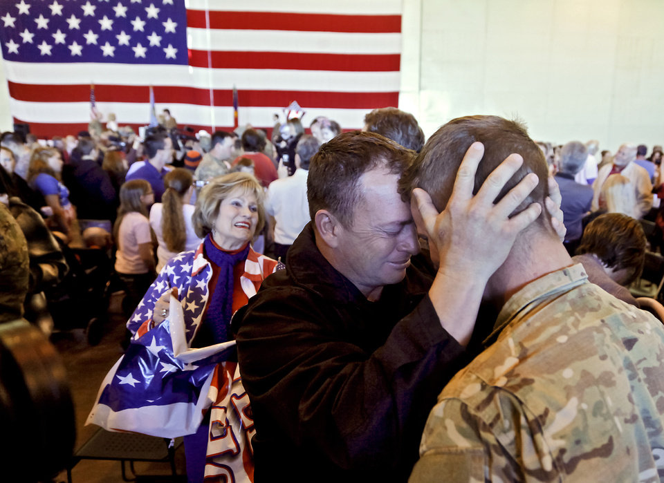 Photo - John Farrow welcomes home his son Justin during the return ceremony for more than 200 National Guard 45th Infantry Brigade Combat Team troops at the National Guard Base on Monday, March 12, 2012, in Oklahoma City, Oklahoma.  Photo by Chris Landsberger, The Oklahoman