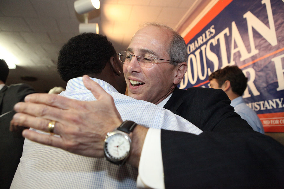 U.S. Rep. Charles Boustany, Jr. hugs voter Sedrick Ned in Lafayette, Louisiana after receiving news of his election to the 3rd Congressional District on Saturday, Dec. 8, 2012. Louisiana congressman Charles Boustany won a fifth term on Saturday by handily defeating his fellow Republican incumbent, Jeff Landry, in a runoff election. (AP Photo/Allyce Andrew, The Advertiser)
