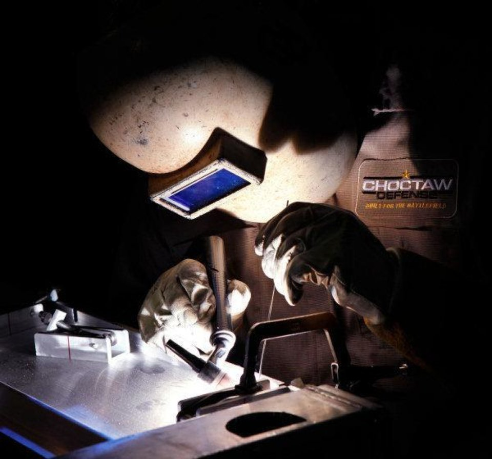 Chad Ratcliff welds corners of a T-62 shipping container in a production area  at Choctaw Defense, a growing company owned by the Choctaw Nation that has lucrative contracts with the Department of Defense. It manufactures shipping containers, trailers and other heavy equipment used by the military. Their plant is located in the Choctaw Business Park on the south side of McAlester.   Photos taken Thursday, June 23, 2011   Photo by Jim Beckel, The Oklahoman ORG XMIT: KOD