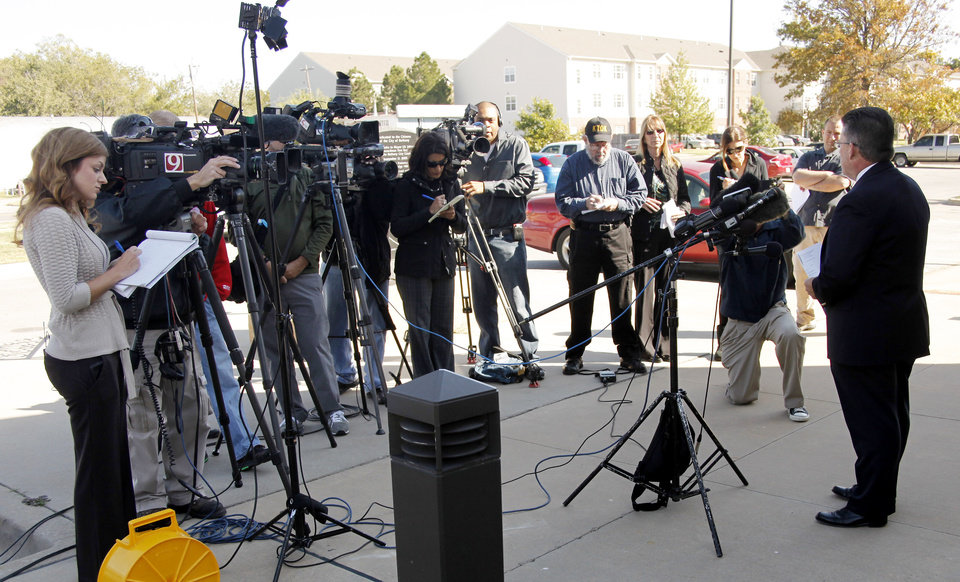 Photo - Bethany Police Chief Phil Cole speaks to the media at the Bethany Police Headquarters concerning two people of interest in the murder of Carina Saunders Wednesday, October 19, 2011. Photo by Doug Hoke, The Oklahoman ORG XMIT: KOD