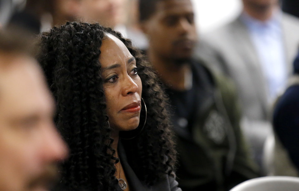 Photo - Jacqueline Blocker, engagement director of Oklahomans for Criminal Justice Reform, reacts after the Pardon and Parole Board read the names of 527 Oklahoma inmates recommend for commutation at the Kate Barnard Correctional Center in Oklahoma City, Friday, Nov. 1, 2019. [Sarah Phipps/The Oklahoman]