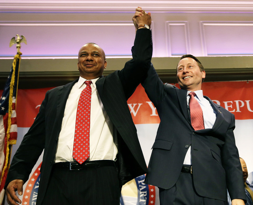 Photo - The Republican nominees Rob Astorino, right, for governor and Christopher Moss for lieutenant governor, stand together on stage during the New York State Republican Convention in Rye Brook, N.Y., Thursday, May 15, 2014. Republicans wrapped up their state party convention Thursday in Westchester County after nominating Astorino and other candidates for statewide office.   (AP Photo/Seth Wenig)