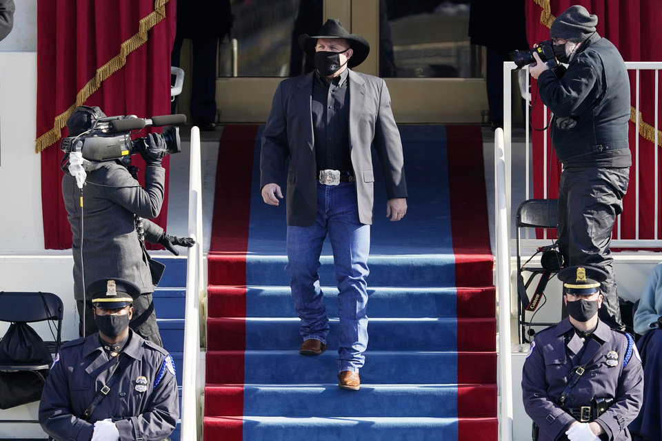 Photo - Garth Brooks arrives to sing Amazing Grace during the 59th Presidential Inauguration at the U.S. Capitol in Washington, Wednesday, Jan. 20, 2021. (AP Photo/Patrick Semansky, Pool)