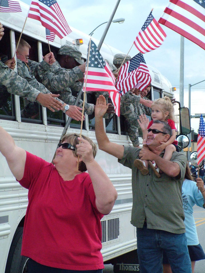 Probably few in the crowd of thousands in Midwest City actually knew any of the National Guardsmen who returned home from Iraq June 15. But it made no difference, it was Mom and Dad and family who welcomed home their sons and daughters with cheers and flags and a lot of happy tears.<br/><b>Community Photo By:</b> Lin Archer<br/><b>Submitted By:</b> Lin, Harrah