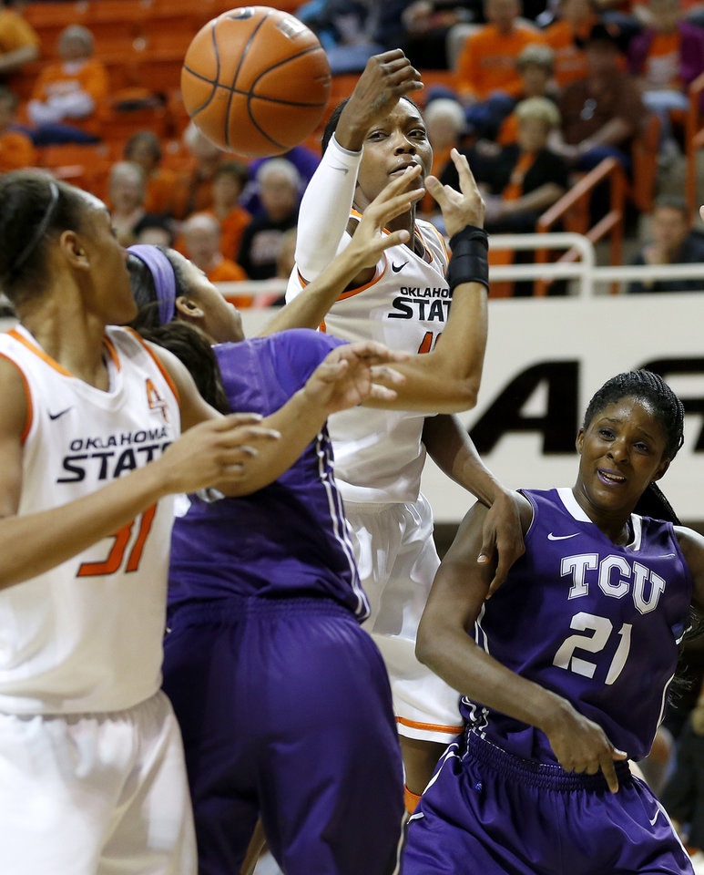 Oklahoma State's Toni Young (15) goes for the ball beside TCU's Latricia Lovings (21) during a women's college basketball game between Oklahoma State University and TCU at Gallagher-Iba Arena in Stillwater, Okla., Tuesday, Feb. 5, 2013. Oklahoma State won 76-59.  Photo by Bryan Terry, The Oklahoman