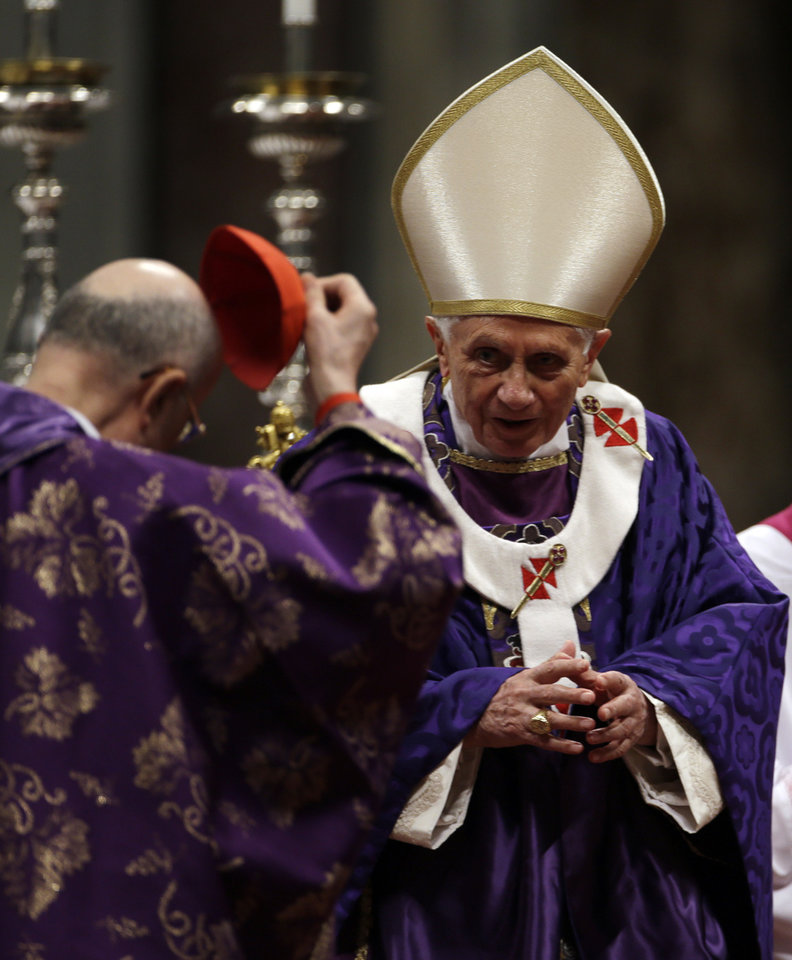 "Vatican Secretary of State Cardinal Tarcisio Bertone takes off his skull cap after he delivered a speech to Pope Benedict XVI at the end of the Ash Wednesday mass in St. Peter's Basilica at the Vatican, Wednesday, Feb. 13, 2013.  Ash Wednesday marks the beginning of Lent, a solemn period of 40 days of prayer and self-denial leading up to Easter. Pope Benedict XVI told thousands of faithful Wednesday that he was resigning for ""the good of the church"", an extraordinary scene of a pope explaining himself to his flock that unfolded in his first appearance since dropping the bombshell announcement. (AP Photo/Gregorio Borgia)"