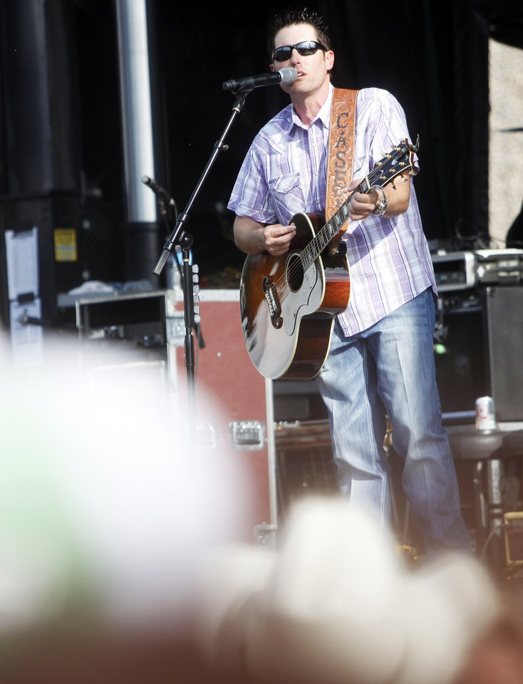 Photo - Country artist Casey Donahew Band performs at OKC Fest in downtown Oklahoma City on Friday, June 27, 2014. OKC Fest is a new two day country music festival with multiple stages downtown. Photos by KT King/The Oklahoman