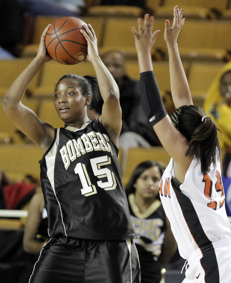 Photo - Midwest City's Richa Jackson (15) looks to pass away from Kim Hayes (13) of Norman during the Class 6A girls high school basketball state tournament final between Midwest City and Norman at the ORU Mabee Center in Tulsa, Okla., Saturday, March 13, 2010. Photo by Nate Billings, The Oklahoman