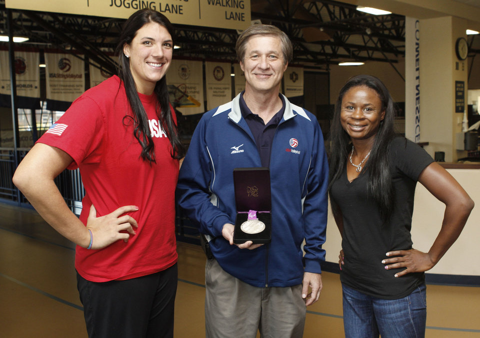 Photo - Coach Bill Hamiter and USA women's sitting volleyball team members Katie Holloway, left, and Kari Miller show their Paralympics silver medal at the University of Central Oklahoma in Edmond.  Photo By Paul Hellstern, The Oklahoman