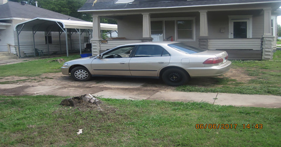 Photo -  This photo, provided by Oklahoma City's code enforcement division, shows yard parking violation. [Photo provided]