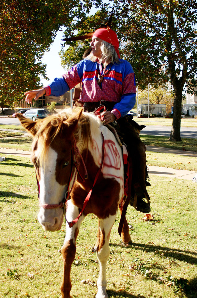 Photo - David Hill, from Sasakwa, on  Pink, at the Oklahoma Indians Survival Walk and Remembrance Ceremony at the Capitol Friday, Nov. 16, 2007. By Michael McNutt, The Oklahoman.
