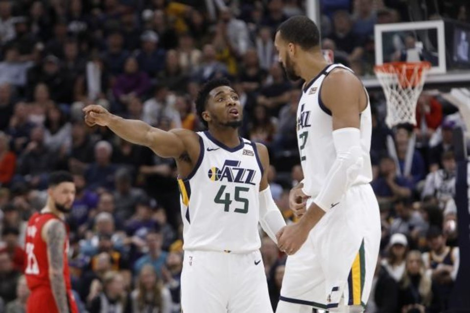 Photo -  Utah's Donovan Mitchell (45) and Rudy Gobert both tested positive for the coronavirus last week while in Oklahoma City. [AP Photo/Kim Raff]