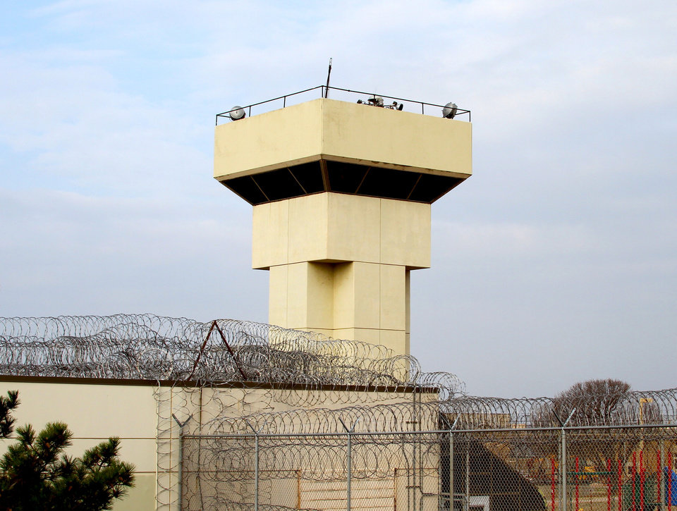 Photo - A guard tower at the Joseph Harp Correctional Center in Lexington. Oklahoma's incarceration rates remain high.