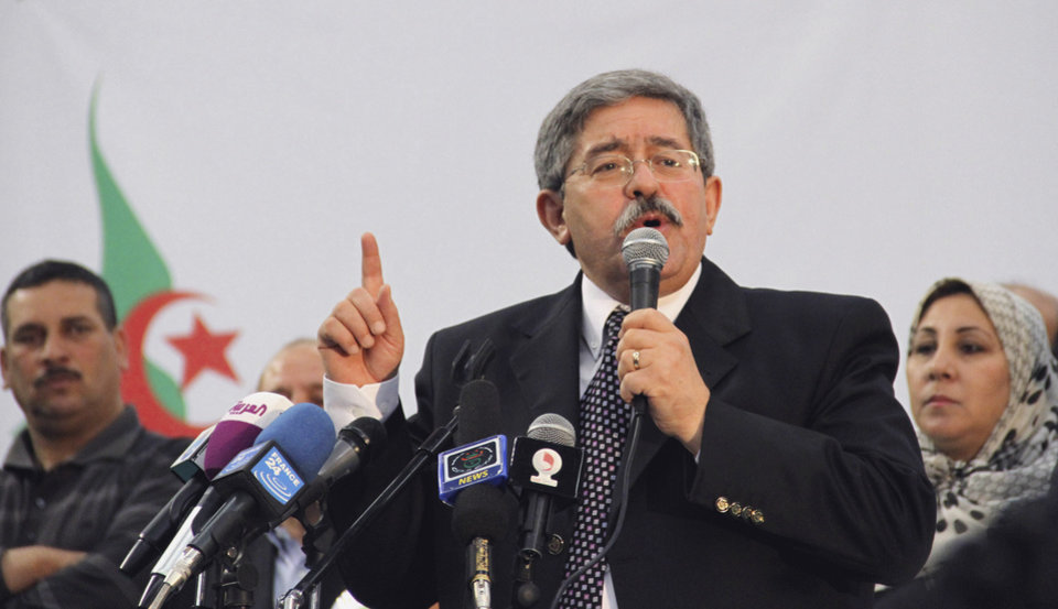 Photo -   FILE - In this Saturday May 5, 2012 file photo, Algerian Prime Minister Ahmed Ouyahia promises continuity if his party, the National Democratic Rally, is re-elected, at the final party rally in the capital Algiers. Algerians riveted are a new string of corruption allegations against top officials that show all the signs of being a behind-the-scenes struggle ahead of key presidential elections in 2014. (AP Photo/Paul Schemm, File)