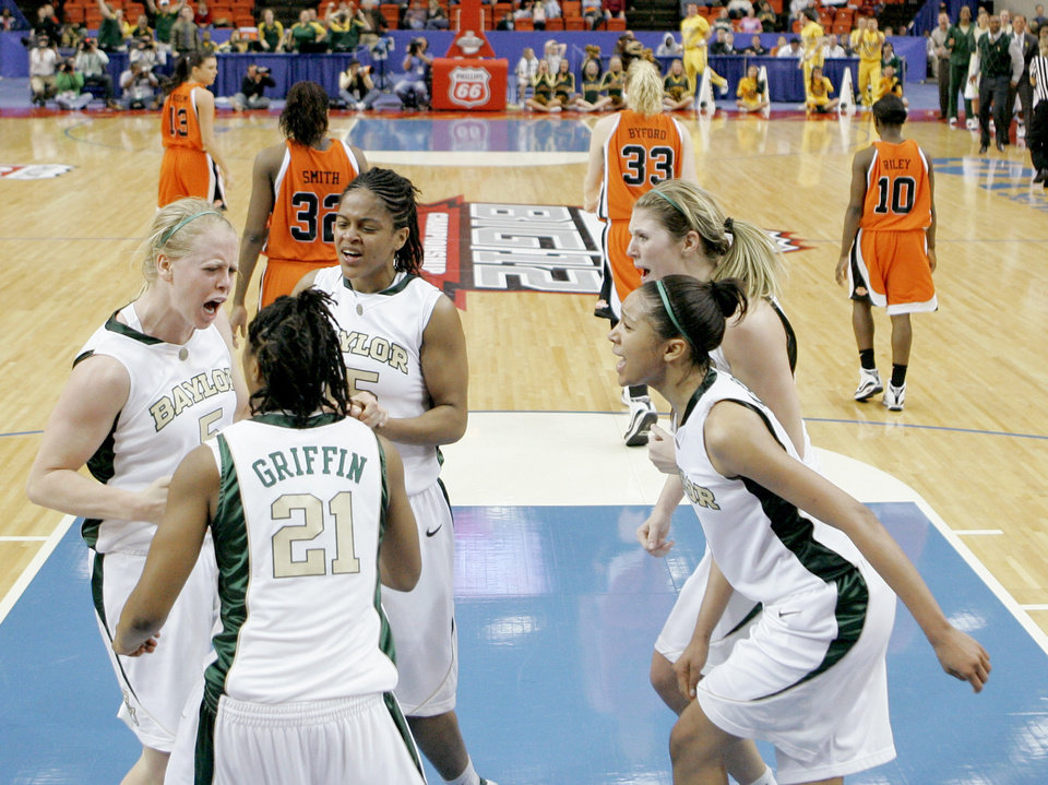 Photo - Baylor's Melissa Jones, left, celebrates with Kelli Griffin, Jhasmin Player, Rachel Allison, and Jessica Morrow after OSU was called for in the final minute of OSU's loss in the Big 12 Women's Championship game between Oklahoma State and Baylor at the Cox Center in Oklahoma City, Friday, March 13, 2009.  PHOTO BY BRYAN TERRY, THE OKLAHOMAN