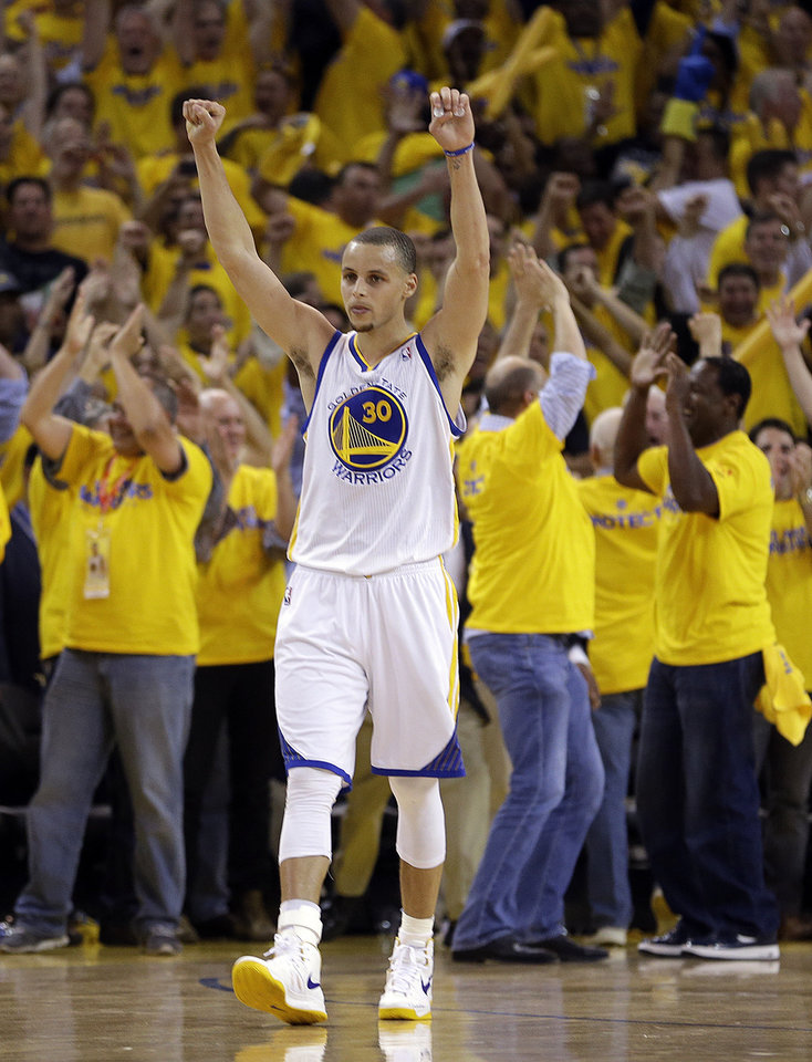 Photo - Golden State Warriors' Stephen Curry celebrates at the end of Game 6 in a first-round NBA basketball playoff series against the Denver Nuggets on Thursday, May 2, 2013, in Oakland, Calif. The Warriors won 92-88. (AP Photo/Ben Margot)