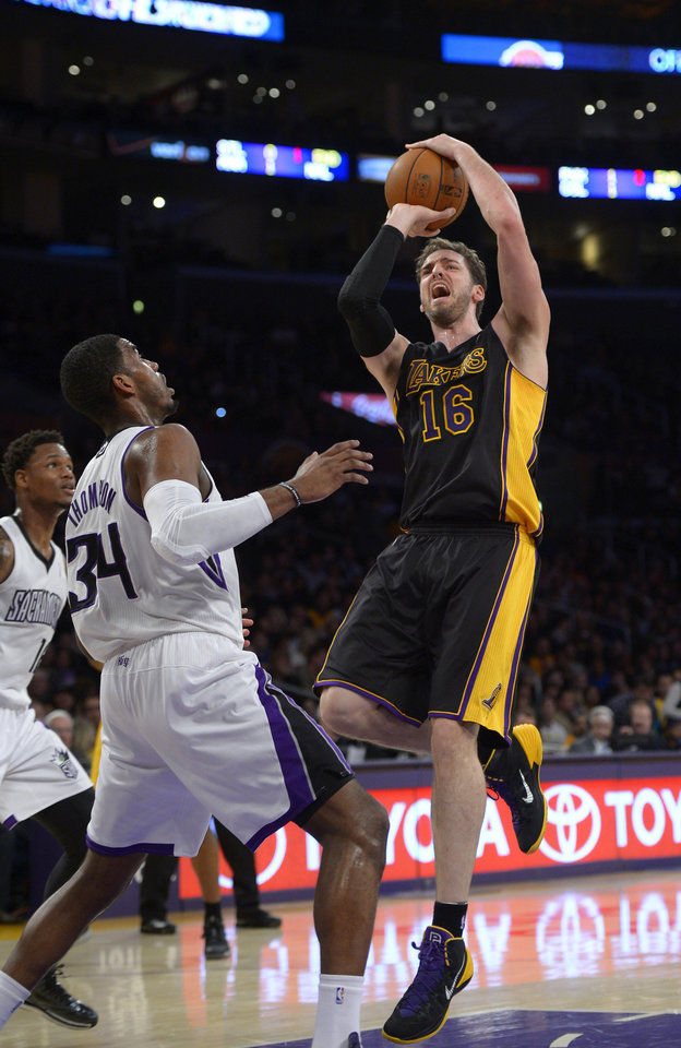 Photo - Los Angeles Lakers center Pau Gasol, of Spain,, right, puts up a shot as Sacramento Kings forward Jason Thompson defends during the first half of an NBA basketball game, Friday, Feb. 28, 2014, in Los Angeles. (AP Photo/Mark J. Terrill)