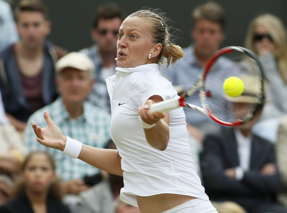 Photo - Petra Kvitova of the Czech Republic plays a return to Peng Shuai of China during their women's singles match at the All England Lawn Tennis Championships in Wimbledon, London, Monday, June 30, 2014. (AP Photo/Alastair Grant)