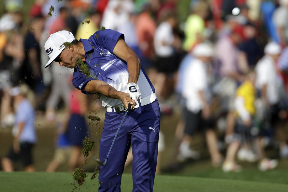 Photo - Rickie Fowler hits from the fairway on the 18th hole during the third round of the PGA Championship golf tournament at Valhalla Golf Club on Saturday, Aug. 9, 2014, in Louisville, Ky. (AP Photo/Jeff Roberson)
