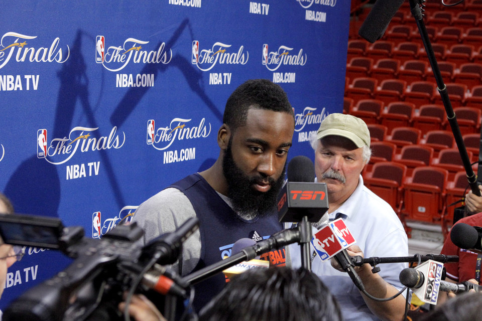 Photo - Oklahoma City's James Harden listens to a question before a practice for Game 5 of the NBA Finals between the Oklahoma City Thunder and the Miami Heat at American Airlines Arena, Wednesday, June 20, 2012. Photo by Bryan Terry, The Oklahoman