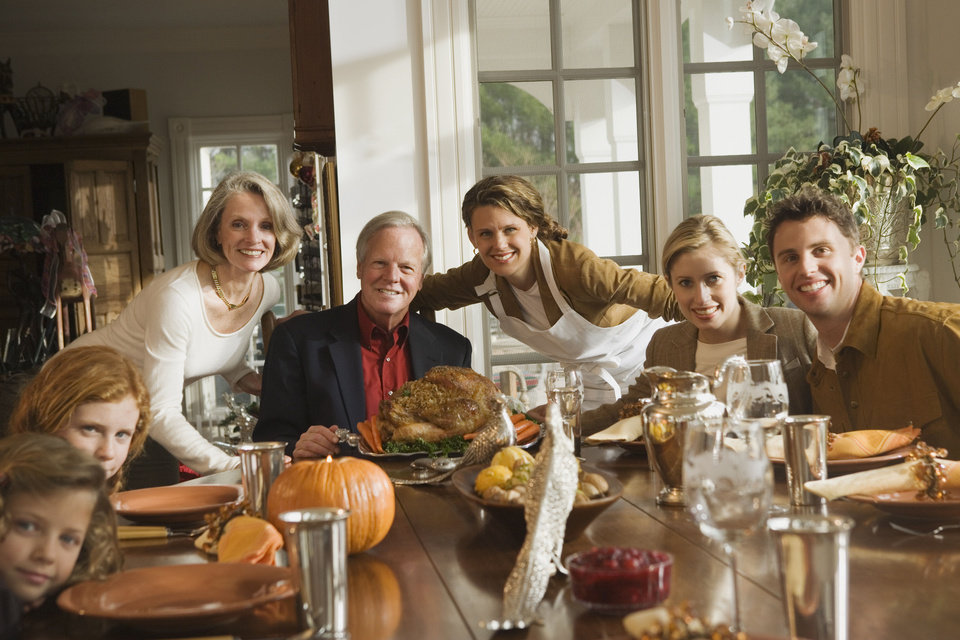 Photo - Family portrait with Thanksgiving dinner