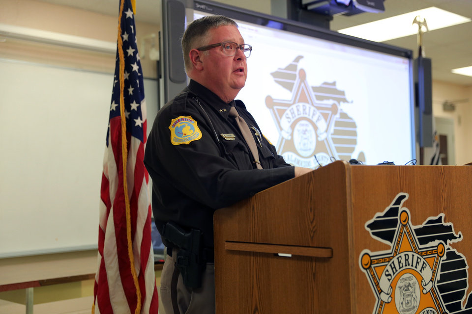 Photo - Kalamazoo County Sheriff Richard Fuller speaks during a news conference in Kalamazoo, Mich. on Wednesday, April 9, 2014. Fuller said an autopsy determined that a body found in an Indiana lake is that of Teleka Patrick, a Michigan doctor who had been missing since December. (AP Photo/Kalamazoo Gazette-MLive Media Group, Mark Bugnaski) ALL LOCAL TV OUT; LOCAL TV INTERNET OUT