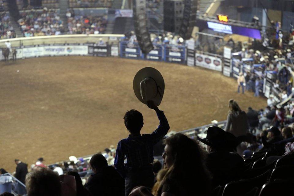 A fan waves his hat as he watches the National Circuit Finals Rodeo at the State Fair Arena in Oklahoma City, Friday, April 5, 2013. Photo by Sarah Phipps, The OklahomaA fan waves his hat as he watches the National Circuit Finals Rodeo at the State Fair Arena in Oklahoma City, Friday, April 5, 2013. Photo by Sarah Phipps, The Oklahoma
