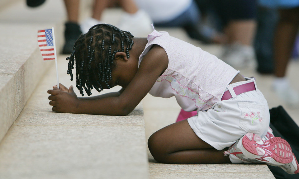 Photo - THIRD PLACE, FEATURE PHOTO: Season Johnson, 4, of OKC kneels on the state Capitol steps after a prayer walk around the Capitol Saturday June 28, 2008 in Oklahoma City, Ok. BY JACONNA AGUIRRE, THE OKLAHOMAN.