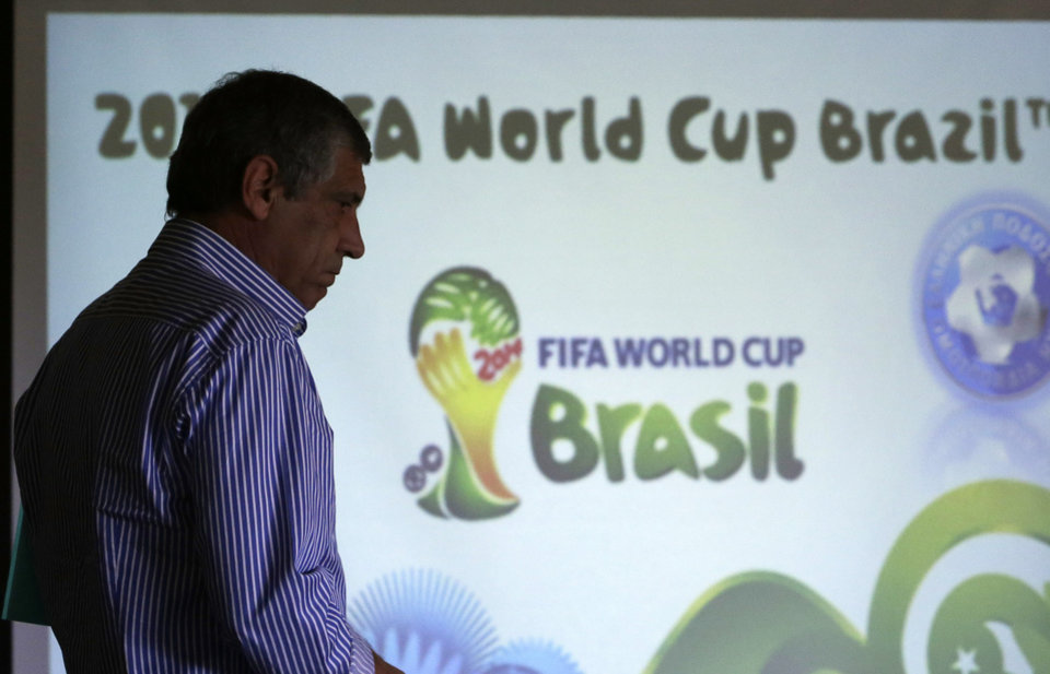 Photo - Greece soccer coach Fernando Santos of Portugal arrives to announce the national soccer squad in Athens on Monday May 19, 2014. Greece will play in Group C with Ivory Coast, Japan and Colombia at the World Cup in Brazil. (AP Photo/Thanassis Stavrakis)
